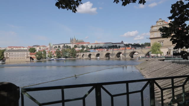 view of charles bridge & vltava with st. vitus cathedral and royal palace, prague, czech republic, europe - hradcany castle stock videos and b-roll footage