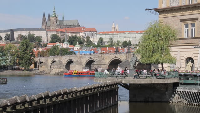 View of Charles Bridge & Vltava with St. Vitus Cathedral and Royal Palace, Prague, Czech Republic, Europe