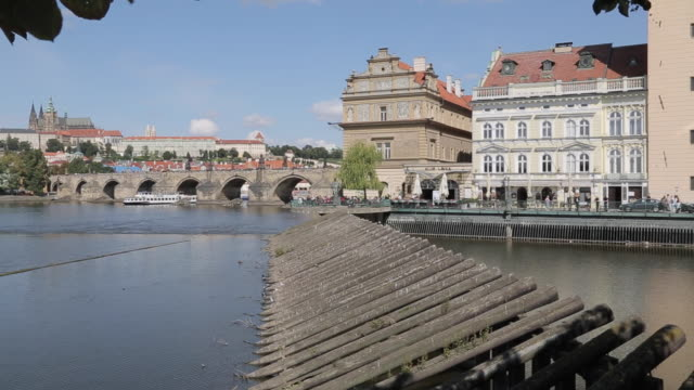 view of charles bridge & vltava with st. vitus cathedral and royal palace, prague, czech republic, europe - charles bridge stock videos & royalty-free footage