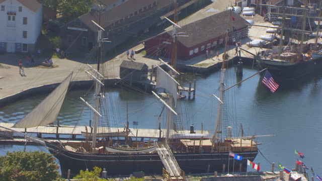 ws zo aerial pov view of charles w. morgan ship with american flag / mystic, connecticut, united states - new london county connecticut stock videos & royalty-free footage