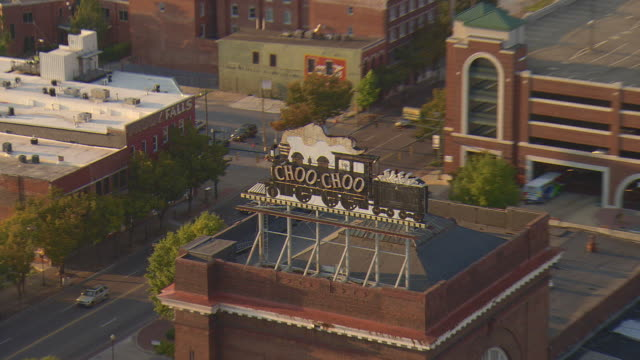 ws aerial zi zo view of chattanooga choo choo train depot with reveal entire building / chattanooga, tennessee, united states  - chattanooga stock videos and b-roll footage