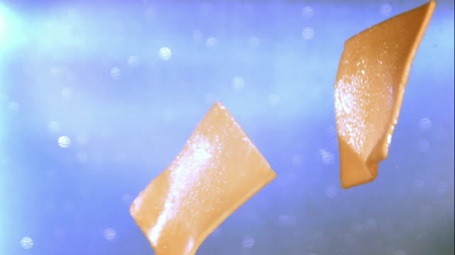 ms slo mo view of cheese tossing / los angeles, ca, united states - チーズ点の映像素材/bロール