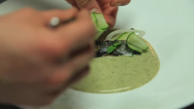 view of chef garnishing on a broiled fish in a plate - food styling stock videos & royalty-free footage