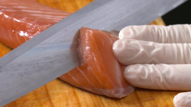 view of chef preparing salmon sashimi on the cutting board - kitchen knife stock videos & royalty-free footage