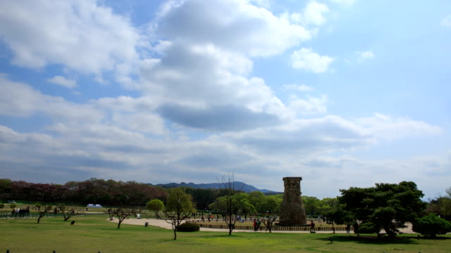 view of cheomseongdae observatory (it is the oldest existing astronomical observatory in asia) in inwang-dong, gyeongju-si - north gyeongsang province stock videos and b-roll footage