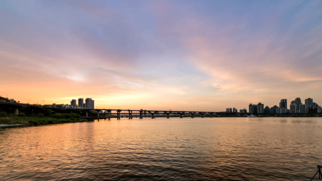 view of cheongdamdaegyo bridge over the han river at day and night time in seoul - time of day stock videos and b-roll footage