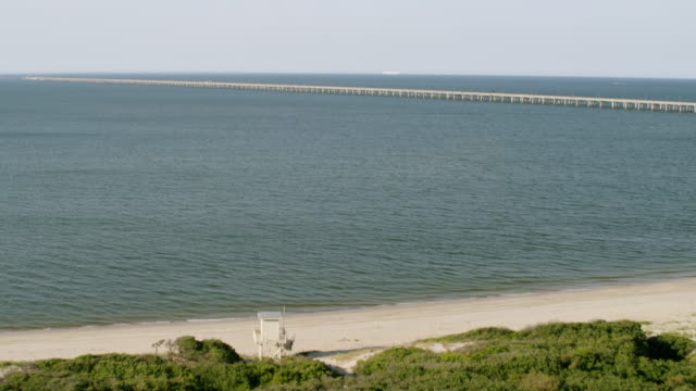 ws tu aerial pov view of chesapeake bay bridge with horizon in background / virginia beach, virginia, united states - virginia beach stock videos & royalty-free footage
