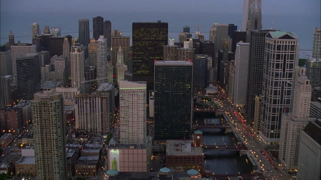aerial view of chicago at dusk, lake michigan in background / illinois, usa - great lakes stock videos & royalty-free footage