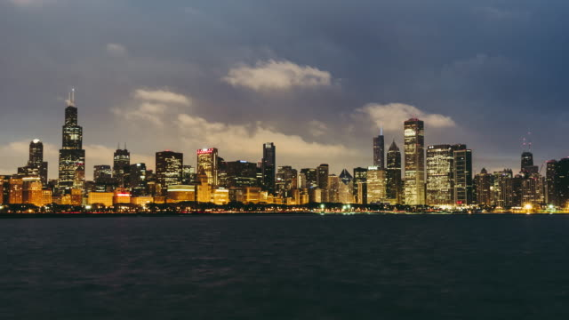 t/l tu view of chicago skyline, night to day transition - willis tower stock videos & royalty-free footage