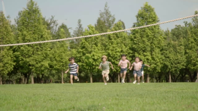 view of children doing track and field in summer at seoulforest (the third largest park in seoul city) - five people stock videos & royalty-free footage