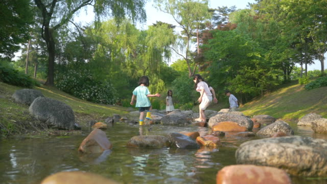 view of children enjoying their time in the stream - korea stock videos & royalty-free footage