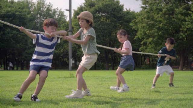 View of children playing tug-of-war in summer at Seoulforest (the third largest park in Seoul city)