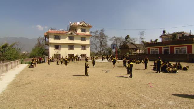 ws view of children's playing on ground of papa's house / kathmandu nepal - waisenhaus stock-videos und b-roll-filmmaterial