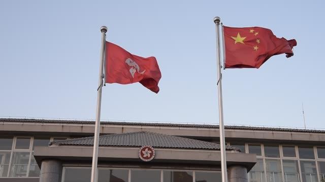 A view of China and Hongkong flags at The Hongkong special administrative region Beijing office