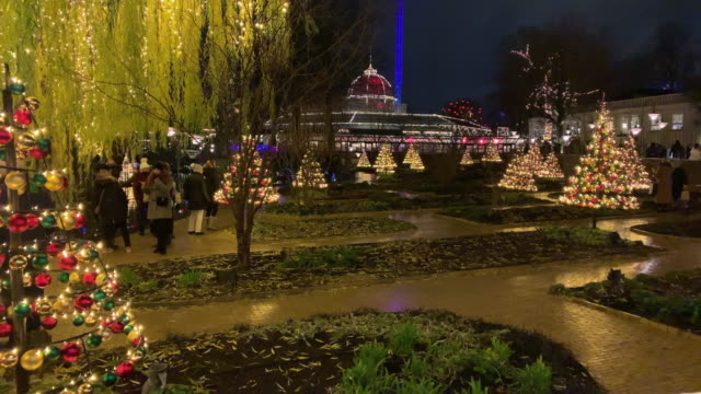 a view of christmas market in tivoli gardens in copenhagen denmark on december 14 2018 christmas in tivoli gardens is tradition amongst copenhageners... - religion stock-videos und b-roll-filmmaterial