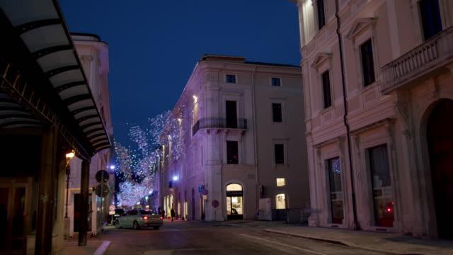 view of christmas tree in l'aquila, italy, on december 16, 2019. the christmas tree in l'aquila is 30 meters high. - 尖り屋根点の映像素材/bロール