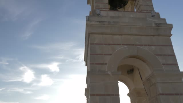 view of church and visitors at summit of mount lycabettus, athens, greece, europe - bell tower tower stock videos and b-roll footage