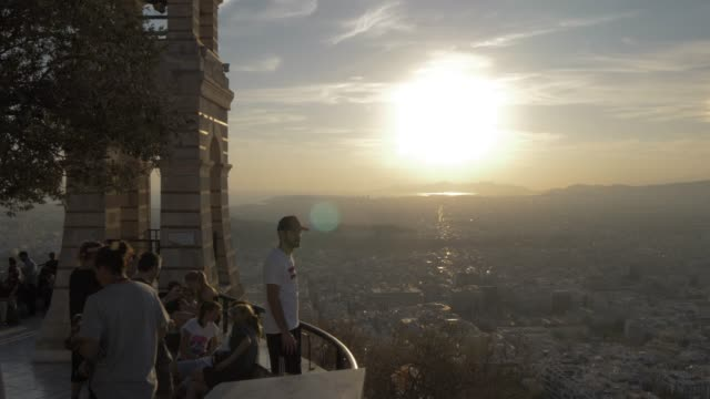 view of church and visitors at summit of mount lycabettus, athens, greece, europe - lycabettus hill stock videos & royalty-free footage