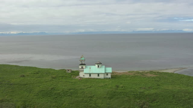MS AERIAL DS View of church by water / Kodiak Island, Alaska, United States