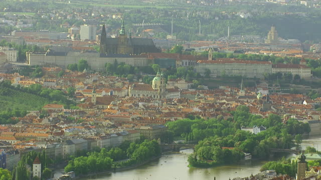 WS AERIAL View of church, castle and bridge / Prague, Czech Republic