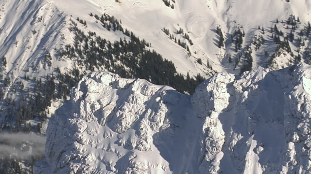 WS AERIAL View of church cross on top of glacier mountain / Oberstdorf, Bavaria, Germany