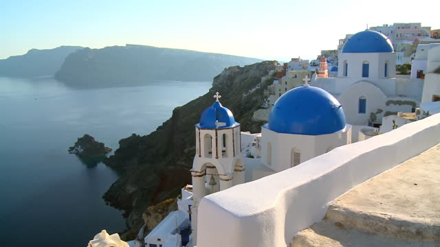 ws view of church dome with ocean at village oia / santorini, cyclades, greece - greece stock videos & royalty-free footage