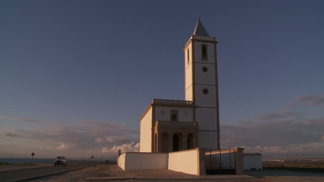 stockvideo's en b-roll-footage met ws view of church of almadraba de monteleva at sunset / monteleva, andalusia, spain - christendom