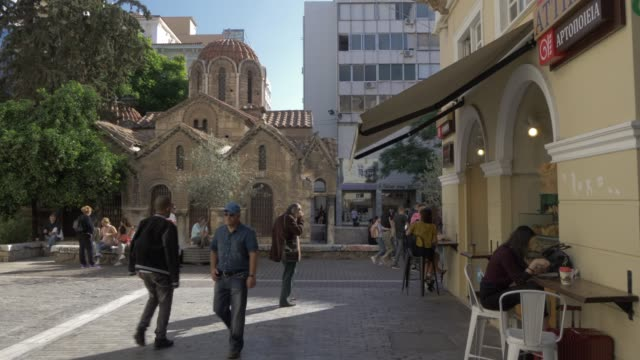 view of church of panaghia kapnikarea on ermou shopping street, monastiraki district, athens, greece, europe - athens greece stock videos & royalty-free footage