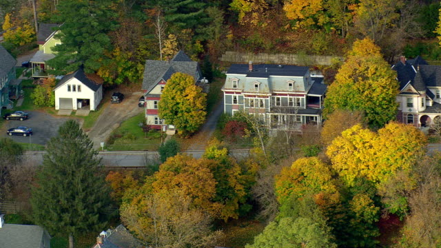 MS AERIAL ZO View of church with autumn color trees in Montpelier city / Vermont, United States