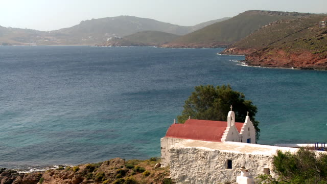 ws view of church with ocean at agios sostis, panormos bay / mykonos, cyclades, greece - mykonos stock videos and b-roll footage
