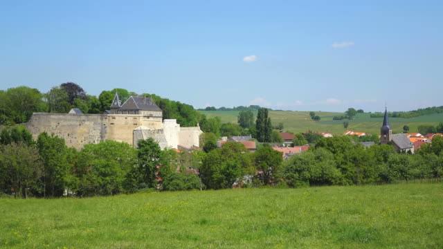 ws view of church with surrounding by trees at village / rodemack, lorraine, france - lorraine stock-videos und b-roll-filmmaterial