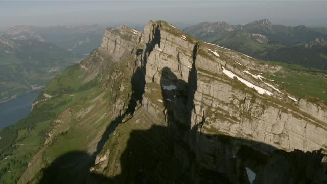 WS AERIAL View of churfirsten from east with summits of zuestoll and Brisi in front with walensee and toggenburg / Churfirsten, St. Gallen, Switzerland