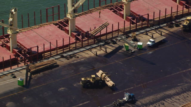 WS AERIAL ZI View of circle crane lifting timber onto barge at Weyerhaeuser paper and pulp mill / Longview, Washington, United States