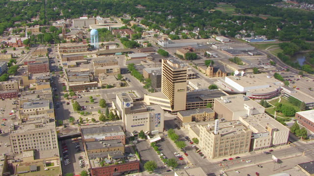 WS AERIAL TS View of Circle high rise building in downtown / Fargo, North Dakota, United States