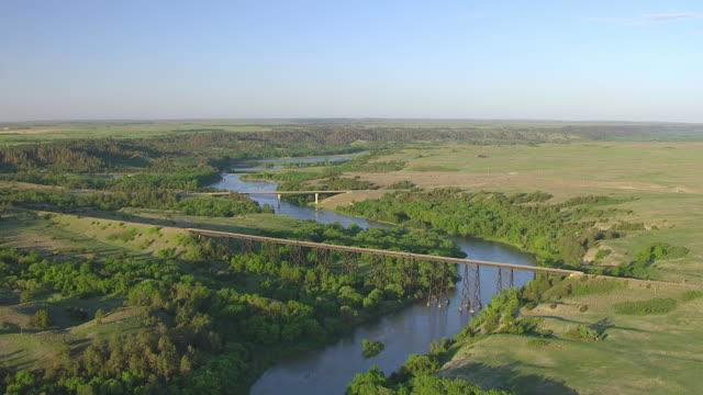 WS AERIAL View of Circle railway bridge over Niobrara River / Nebraska, United States