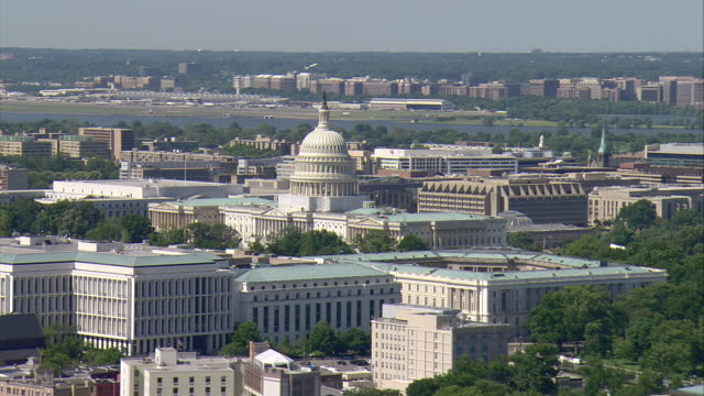 WS AERIAL ZI DS View of circling Capitol Building with plane taking off and Washington Monument / Washington, Dist. of Columbia, United States