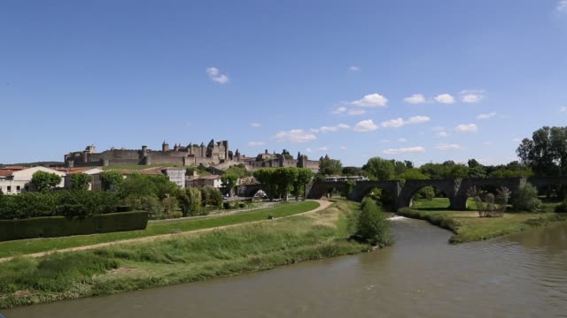view of cité de carcassonne across river - carcassonne stock videos & royalty-free footage