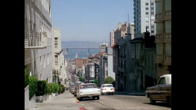 ws view of city and bay, cars moving on street down hill / san francisco, california, united states - 1960 stock videos & royalty-free footage