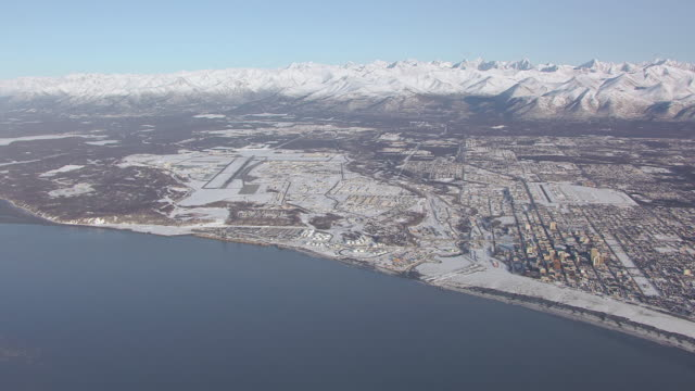 WS AERIAL PAN View of city and Chugach mountains / Anchorage, Alaska, United States