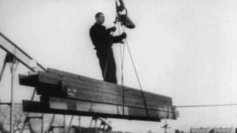 ws aerial view of city and  express train / united states - 1930 bildbanksvideor och videomaterial från bakom kulisserna