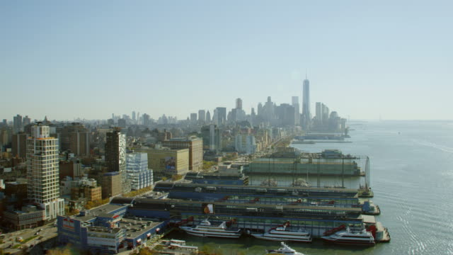 ws aerial view of city and harbor with yachts anchored / new york city   - new york harbor stock videos & royalty-free footage