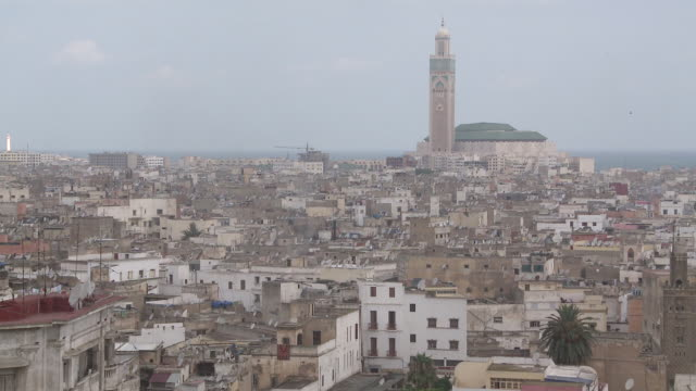 ws view of city and hassan mosque  /casablanca, unspecified, morocco - casablanca morocco stock videos & royalty-free footage