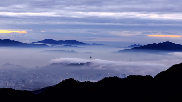 view of city and n seoul tower from mountain peak(insubong) at mt. bukhansan - peak tower stock videos and b-roll footage
