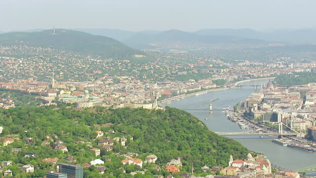 ws aerial view of city and old chain bridge / budapest, hungary - chain bridge suspension bridge stock videos & royalty-free footage