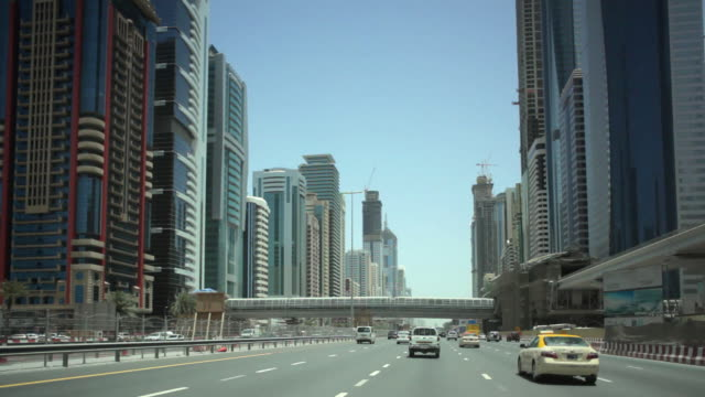 ws pov view of city and traffic through sheikh zayed road / dubai, united arab emirates - vereinigte arabische emirate stock-videos und b-roll-filmmaterial