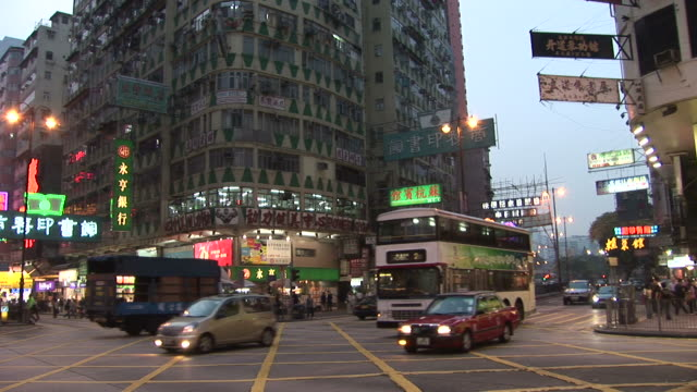 view of city at magic hour in hong kong china - bankenschild stock-videos und b-roll-filmmaterial