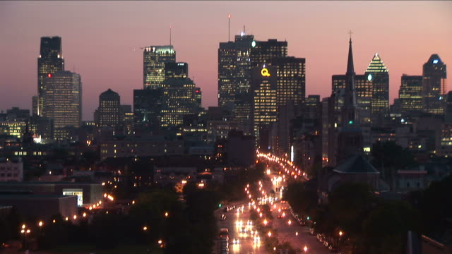 view of city at magic hour in montreal canada - montréal stock videos & royalty-free footage