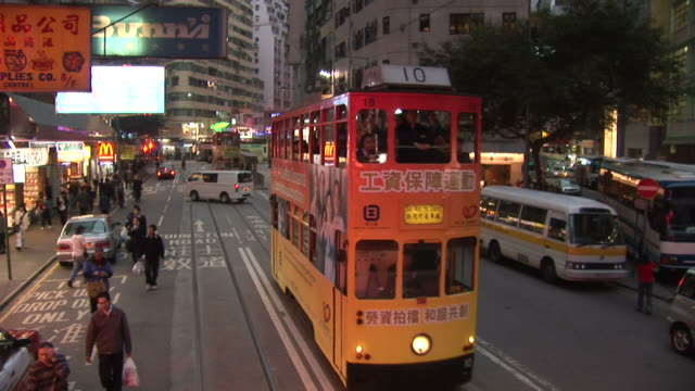 vidéos et rushes de view of city at night from a moving tram in hong kong china - ligne de tramway