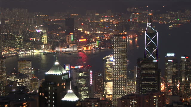 vidéos et rushes de view of city at night in hong kong china - wide shot