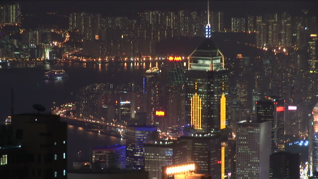 view of city at night in hong kong china - central plaza hong kong stock-videos und b-roll-filmmaterial